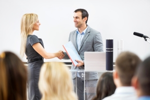 Group of people on a seminar. Focus is on business woman receiving a certificate from a lecturer. [url=http://www.istockphoto.com/search/lightbox/9786622][img]http://dl.dropbox.com/u/40117171/business.jpg[/img][/url] [url=http://www.istockphoto.com/search/lightbox/9786738][img]http://dl.dropbox.com/u/40117171/group.jpg[/img][/url]