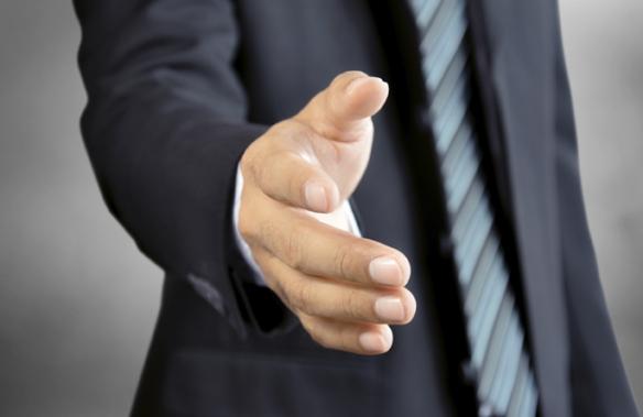 Businessman hand offering handshake